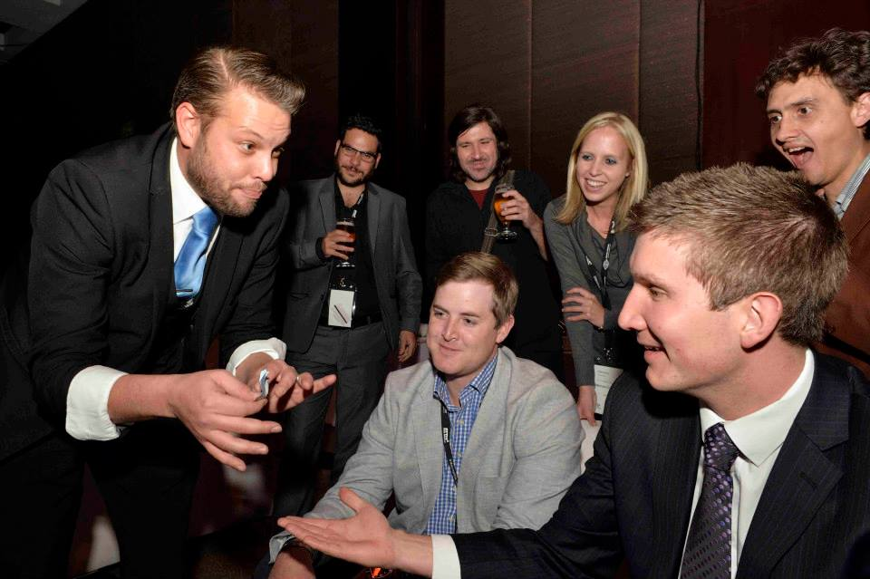 Stunned audience members watch Marcel Oudejans performing close-up magic