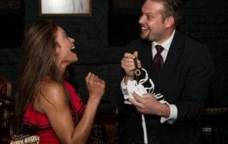 Marcel Oudejans returns a watch to a surprised guest