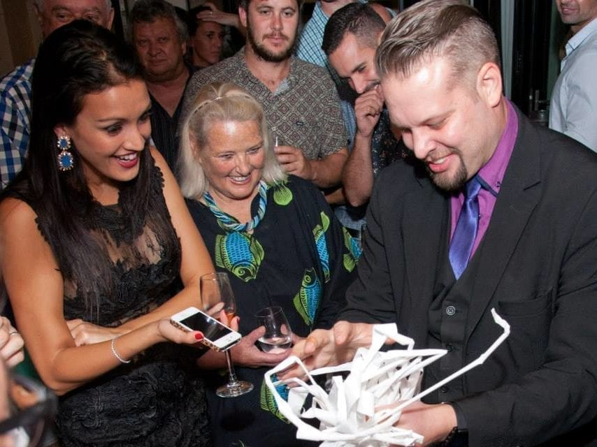 Marcel Oudejans performs close-up magic at a private event